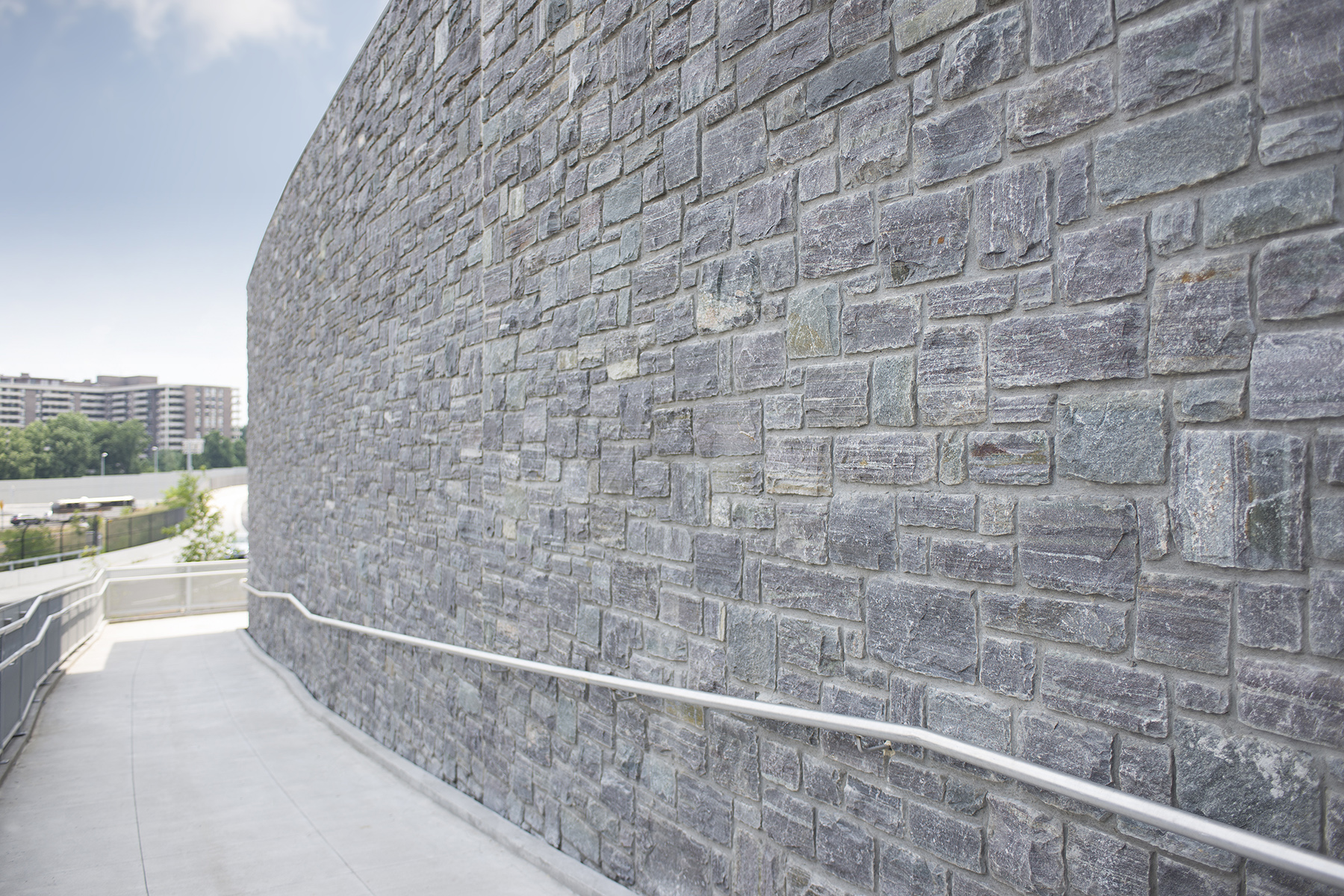 large stone wall with railing