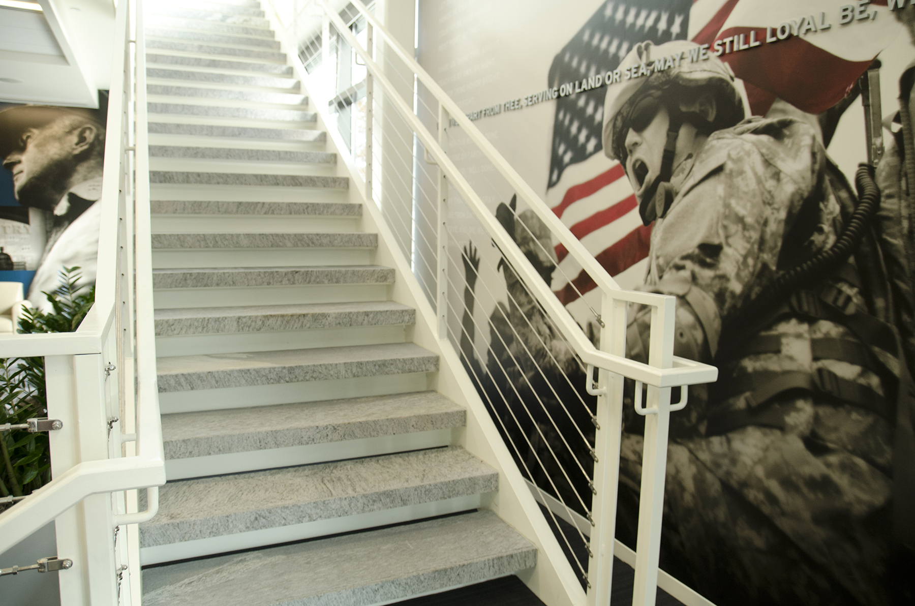 stone stairs with solider art in background